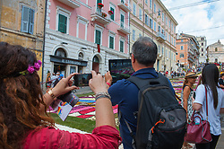 June 18, 2017 - Genzano, Rome, Italy - Again this year, from 17 to 19 June, the traditional 'Infiorata' was repeated in the small town of the Roman castles, which dates back to 1778. The religious, historical and folkloric event extends over an area of about 2000 square meters, covered with thousands of flower petals used to make designs that change every year. It is held in the recurrence of the Corpus Domini, on which after the Eucharistic celebration there is a procession presided by the Bishop, on the streets of the town and on the site of the Infiorata presided by the Bishop and the participation of local civilian and military authorities. (Credit Image: © Leo Claudio De Petris/Pacific Press via ZUMA Wire)