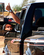 """Texas Governor and Republican presidential candidate George W. Bush gives a thumbs up as he bids farewell to a visitor while driving off in his pickup on his rural Crawford, Texas ranch September 16, 2000.  Bush calls himself a """"windsheild rancher"""" as he enjoys driving around his ranch regularly.  REUTERS/Rick Wilking"""