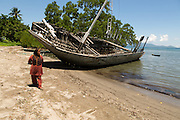 Community leader Siti Rofi'ah, 45, walks down the beach near her home in Lewoleba, Nubatukan subdistrict, Lembata district, East Nusa Tenggara province, Indonesia.