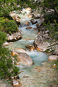 Drive or walk the scenic Soca Trail (Soska pot) along the Soca River gorge, Trenta Valley, Triglav National Park (Triglavski narodni park, TNP), Slovenia, Europe. The crystal clear Soca retains an unusually beautiful emerald green color throughout its length. From 1915-1917, over 600,000 Austro-Hungarian and Italian soldiers lost their lives in the Soca River valley in twelve battles of the Isonzo on the Italian front in World War I. The Julian Alps (Slovene: Julijske Alpe, Italian: Alpi Giulie) stretch from north-eastern Italy to Slovenia in the Southern Limestone Alps. The namesake for the Julian Alps, Julius Caesar, founded the municipium of Cividale del Friuli at their foot. [Some Slovene letters ? and ? may not appear correctly in this media, as in So?a Trail / So?ka pot.]