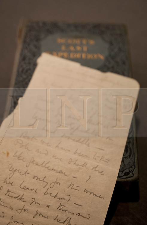 """© licensed to London News Pictures. London, UK 22/03/2012. The final letters written by Captain Scott pictured with """"Scott's Last Expedition"""" book by Robert Falcon. The letters were written as he laid near death in the Antarctic, which is estimated at £100,000 to £150,000, going to be sold on March 30th by Bonhams, London. Photo credit: Tolga Akmen/LNP"""