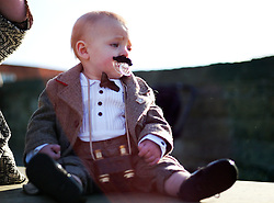 © Licensed to London News Pictures. <br /> 01/11/2014. <br /> <br /> Whitby, Yorkshire, United Kingdom<br /> <br /> Archie Dale, 11 months is dressed for the occasion as he attends the 20th anniversary of the Whitby Goth Weekend with his mother.<br /> <br /> The event this weekend brings together thousands of extravagantly dressed followers of Victoriana, Steampunk, Cybergoth and Romanticism who all visit the town to take part in celebrating Gothic culture. This weekend marks the 20th anniversary since the event was started by local woman Jo Hampshire.<br /> <br /> Photo credit : Ian Forsyth/LNP