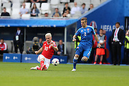 Aaron Ramsey of Wales gets in a shot at goal as Peter Pekarik of Slovakia ® looks on. Euro 2016, Wales v Slovakia at Matmut Atlantique , Nouveau Stade de Bordeaux  in Bordeaux, France on Saturday 11th June 2016, pic by  Andrew Orchard,