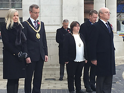 Dignitaries observe a two minute silence outside Belfast City Hall on Armistice Day.