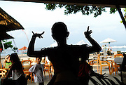 Silhouette of young girl practising dance at traditional Balinese dance school. Sanur, Bali, Indonesia