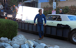 EXCLUSIVE: Brad Pitt filming the Quentin Tarantino movie 'Once Upon a Time in Hollywood' in Los Angeles. Pitt is seen jumping from the window of a vintage Cadillac, being carried on the back of a flatbed trailer. In one shot, he is smiling as he attempts to get his footing on some rocks on the ground. The movie also stars Leonardo DiCaprio and Margot Robbie and is set to be centered around the Manson Family murders. Robbie stars as actress Sharon Tate next to DiCaprio as Rick Dalton, the former star of a western TV series, and Pitt as his longtime stunt double Cliff Booth. 11 Sep 2018 Pictured: Brad Pitt, Quentin Tarantino. Photo credit: MEGA TheMegaAgency.com +1 888 505 6342