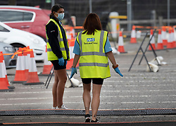 © Licensed to London News Pictures. 16/09/2020. Chessington, UK. NHS Test and Trace staff wait for people to arrive at a Coronavirus testing centre in a car park at Chessington World of Adventures, south west of London. The Government have faced criticism after people face delays in getting tested for the virus. Photo credit: Peter Macdiarmid/LNP