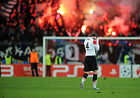 Football - Champions League - FC Basel vs. Manchester United<br /> Phil Jones of Manchester United looks dejected as he walks from the pitch in front of jubilant Basel fans at St. Jakob Park, Basel