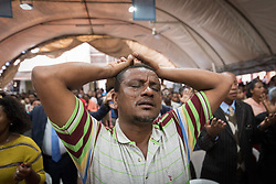 27 October 2019, Addis Ababa, Ethiopia: A man raises his arms in prayer suring Sunday service at the Finfinne Oromo Mekane Yesus Congregation of the Ethiopian Evangelical Church Mekane Yesus. In a context where congregations did not use to be allowed to hold their services in any language but Amharic, the congregation today is one of some 60 Oromo speaking Mekane Yesus congregations in Addis Ababa. The service takes place on the first Sunday following political turmoil in the country, claiming dozens of lives.