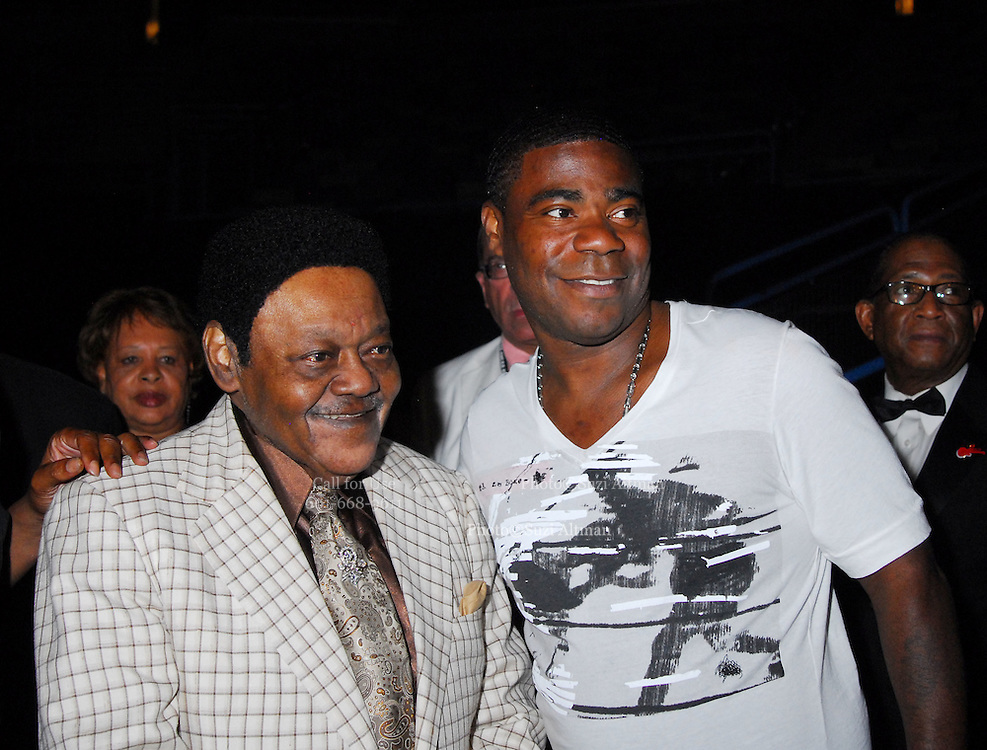 """Legendary musician Antoine Dominque """"Fats Domino"""" greets comedian Tracey Morgan as he walks off stage  after he performed in New Orleans Saturday May 30,2009 as part of the Domino Effect Benefit concert which also featured B.B. King and Chuck Berry. Domino Effect Benefit Concert legendary performers gather in New Orleans at the Arena to raise funds and awarness for hurricane Katrina rebuilding for Fats Domino the Tipatina Foundation and the Drew Brees' foundation. Photo©Suzi Altman ALL IMAGES ©SUZI ALTMAN. IMAGES ARE NOT PUBLIC DOMAIN. CALL OR EMAIL FOR LICENSE, USE, OR TO PURCHASE PRINTS 601-668-9611 OR EMAIL SUZISNAPS@AOL.COMPhoto©Suzi Altman"""