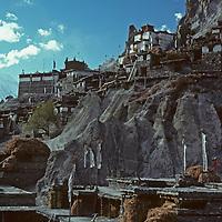 NEPAL, HIMALAYA. A Tibetan Buddhist monastery sits high on a hill above Braga Village in Manang Valley, north of Annapurna massif.