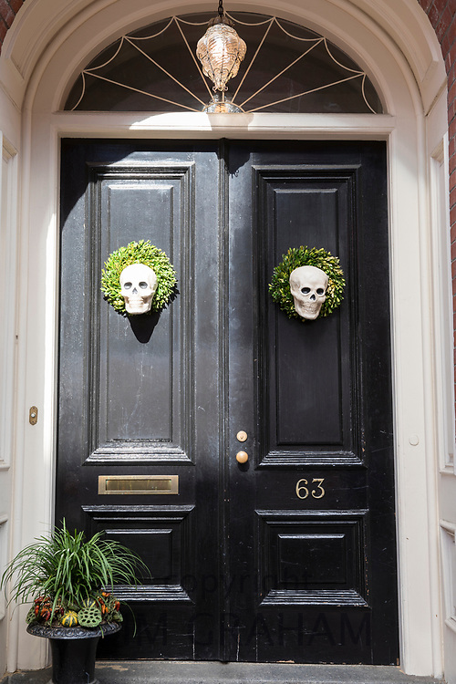 Halloween skulls on elegant front door of a home in the Beacon Hill historic district of Boston, Massachusetts, USA