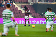 Beni Baningime (#6) of Heart of Midlothian FC bows his head, as the Celtic players take a knew before the Cinch SPFL Premiership match between Heart of Midlothian FC and Celtic FC at Tynecastle Park, Edinburgh, Scotland on 31 July 2021.