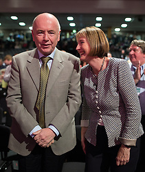 © Licensed to London News Pictures . 27/09/2015 . Brighton , UK . HARRIET HARMAN (r) is applauded by her husband JACK DROMEY (l) after a tribute to her record as Deputy Leader , at the 2015 Labour Party Conference . Photo credit : Joel Goodman/LNP
