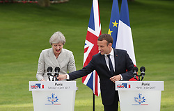 French President Emmanuel Macron and Prime Minister Theresa May prepare to speak at a joint press conference at the Elysee Palace during her visit to Paris, France.