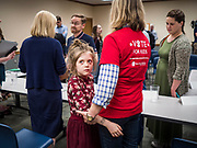 """24 MAY 2019 - WEST DES MOINES, IOWA: JEN STATLER, right, hugs her granddaughter, MYLAH STATLER, 7, while they wait to talk to US Senator KIRSTEN GILLIBRAND (D-NY), left, after Gillibrand's forum on family rights in the West Des Moines Public Library. Gillibrand unveiled her """"Family Bill of Rights"""" during a forum in West Des Moines. The New York Senator has made family health and rights a centerpiece of her campaign. She is touring Iowa this week to support her candidacy to be the Democratic nominee for the US Presidency. Iowa traditionally hosts the the first selection event of the presidential election cycle. The Iowa Caucuses will be on Feb. 3, 2020.           PHOTO BY JACK KURTZ"""