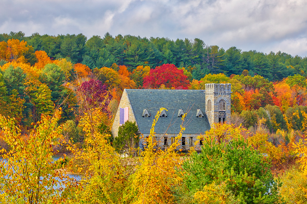 New England fall foliage at the historic Old Stone Church in West Boylston, Central Massachusetts.