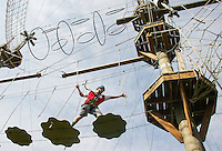 Cody Barton of Alexandria crosses over obstacles on the Monkey Trunks Rope Course on Thursday morning.  (Karen Bobotas/for the Laconia Daily Sun)