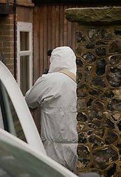 © Licensed to London News Pictures. 24/10/2020. Christmas Common, UK. A police forensics investigator enters a house at Christmas Common where it is reported that a man entered the property and was found naked by the home owner - after the body of a woman was found on Friday 23rd October at nearby Watlington Hill. An injured man was arrested by police nearby after a man was seen acting suspiciously in a pub. Photo credit: Peter Macdiarmid/LNP