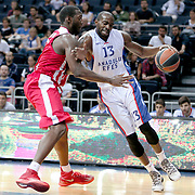 Anadolu Efes's Stephane Lasme (R) during their Gloria Cup Basketball Tournament match Anadolu Efes between Olympiacos at Ulker Sports Arena in istanbul Turkey on Tuesday 23 September 2014. Photo by Aykut AKICI/TURKPIX