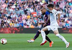 BARCELONA, May 13, 2019  Barcelona's Arturo Vidal (L) vies with Getafe's Mauro Arambarri during a Spanish league match between FC Barcelona and Getafe in Barcelona, Spain, on May 12, 2019. FC Barcelona won 2-0. (Credit Image: © Joan Gosa/Xinhua via ZUMA Wire)