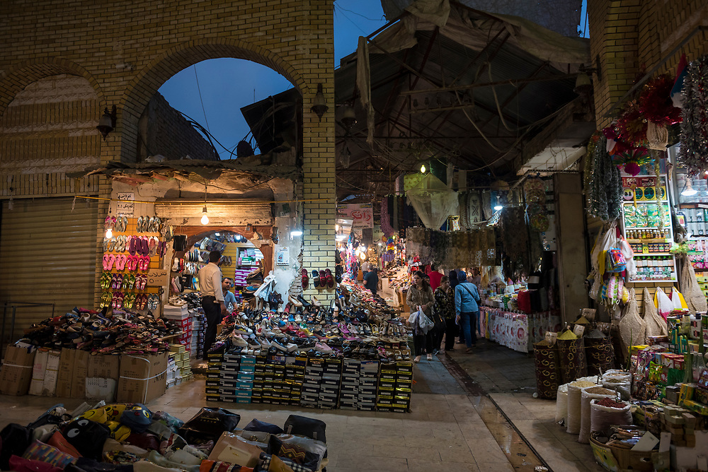 Erbil, Iraq - May 1, 2017: In the hour after sunset, a view of shops, including one selling shoes, at the souk in Erbil, Iraq. Erbil is a predominately Kurdish city.