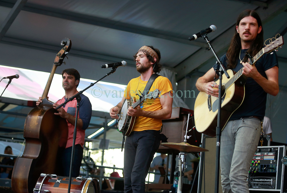 25 April 2014. New Orleans, Louisiana.<br /> The Avett Brothers play the New Orleans Jazz and Heritage Festival. <br /> L/R; Seth Avett, Scott Avett and Bob Crawford<br /> Photo; Charlie Varley/varleypix.com