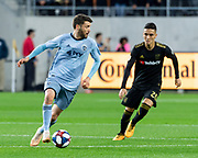 Sporting KC midfielder Ilie Sanchez (6) dribbles the ball against LAFC midfielder Eduard Atuesta (20) during a MLS soccer match in Los Angeles, Sunday, March 3, 2019. LAFC defeated Sporting KC, 2-1. (Ed Ruvalcaba/Image of Sport)
