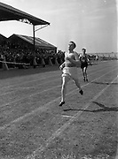 05/07/1952<br /> 07/05/1952<br /> 05 July 1952<br /> N.A.C.A. (National Athletic and Cycling Association) Championship of Ireland Finals at Iveagh Grounds, Crumlin, Dublin. S. Dobbyns (Ballincollig) winning 880yd Flat Championship, just behind is J.J. Kelly (Phoenix).