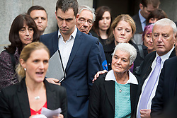 © Licensed to London News Pictures. 23/11/2016. London, UK. Jo Cox's sister Kim Leadbeater reads a statement in front of Brendan Cox, and parents Jean and Gordon Leadbeater outside the Old Bailey in London where a guilty verdict was returned in the murder trial of Labour MP Jo Cox. Thomas Mair was found guilty of shooting and stabbing the mother-of-two in Birstall, West Yorkshire, on 16 June. Photo credit: Ben Cawthra/LNP