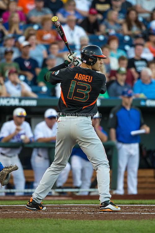 Willie Abreu (13) of the Miami Hurricanes bats during a game between the Miami Hurricanes and Florida Gators at TD Ameritrade Park on June 13, 2015 in Omaha, Nebraska. (Brace Hemmelgarn)