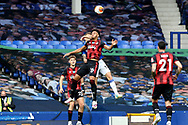 Bournemouth defender Lloyd Kelly (26) and Everton defender Lucas Digne (12) challenge for the high ball during the Premier League match between Everton and Bournemouth at Goodison Park, Liverpool, England on 26 July 2020.