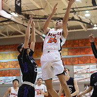 Gallup Bengal Quinn Atazhoon (24) drives to the basket for a layup during their 1-4A semi-final tournament game against the Miyamura Patriots Wednesday night at Gallup High School. Gallup took the win 72-39.