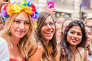 Colourful fans line the streets - The London Pride parade and event in Trafalgar Square.
