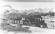 Leased D&RGW #464 with southbound RGS freight at Lizard Head coming out of snowshed and making heavy smoke.<br /> RGS  Lizard Head, CO  Taken by Perry, Otto C. - 6/26/1945<br /> Also at RD137-142 (better image).<br /> Thanks to Don Bergman for additional information.