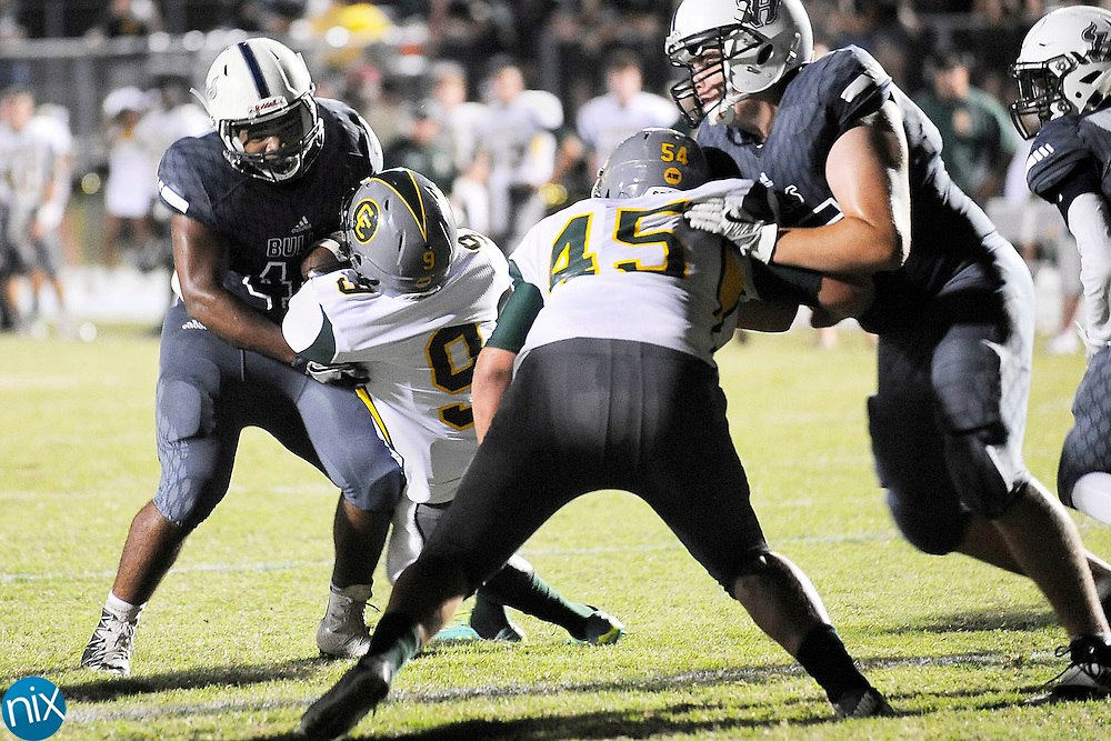 Ragin' Bulls running back Jeremiah Boyd (44) is stopped behind the line of scrimmage by Vikings safety Kevin Peebles (9) during the Central Cabarrus Vikings at Hickory Ridge Ragin' Bulls high school football game on Friday  night.