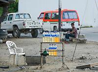 Vendors sell gasoline in re-used one liter water bottles on the street in Dili, Timor-Leste (East Timor)