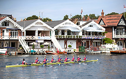 Spectators gather to watch the rowing during day one of the 2018 Henley Royal Regatta alongside the river Thames.