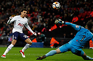 Dele Alli of Tottenham Hotspur (L) takes a shot at goal and hits the crossbar. The Emirates FA Cup, 4th round replay match, Tottenham Hotspur v Newport County at Wembley Stadium in London on Wednesday 7th February 2018.<br /> pic by Steffan Bowen, Andrew Orchard sports photography.