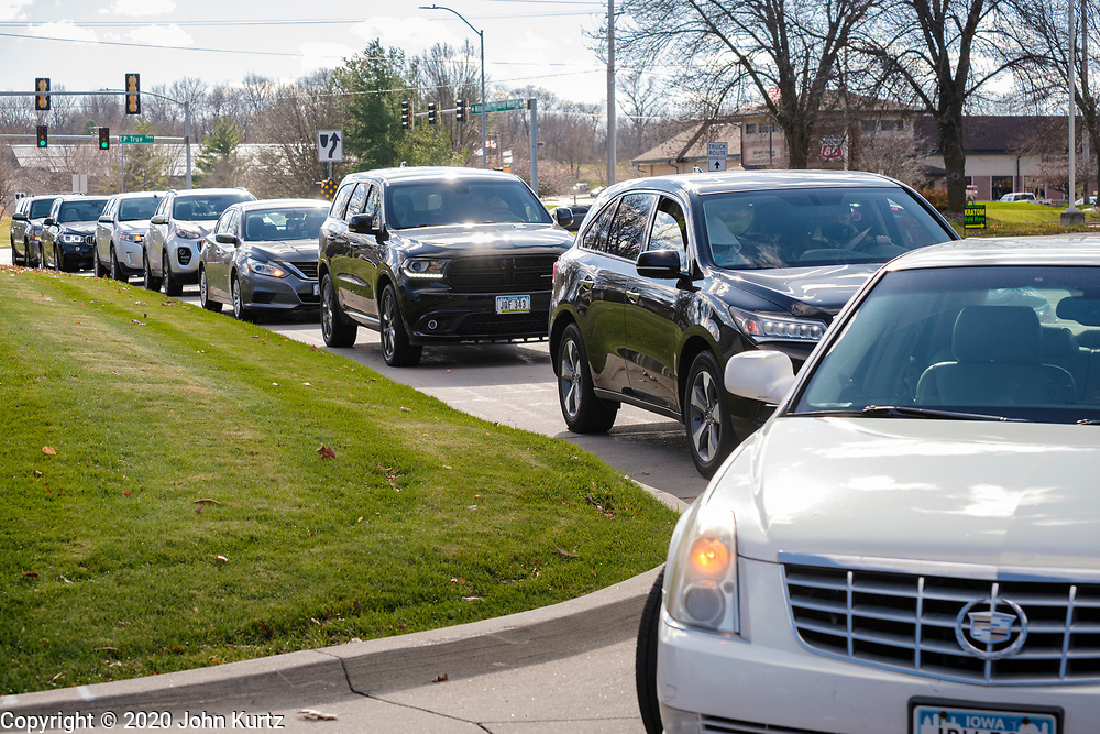 """15 NOVEMBER 2020 - WEST DES MOINES, IOWA: People sit in the cars in line for a drive up rapid COVID test. Hundreds of people lined up for drive up COVID-19 tests at the Doctors NOW clinic in West Des Moines. Iowa is seeing a surge in COVID-19 (Coronavirus) cases and the state's """"Test Iowa"""" public testing program is swamped with some people waiting 3 - 5 days for an appointment for a drive up test. As of Sunday, 15 November, Iowa had the 3rd highest Coronavirus (SARS-CoV-2) infection rate in the country with 4,432 new cases reported in the previous 24 hours and 1,279 people hospitalized for COVID-19. Des Moines area hospitals have warned that they are at capacity and many hospitals are reporting staffing shortages because workers have come down with COVID-19.     PHOTO BY JACK KURTZ"""