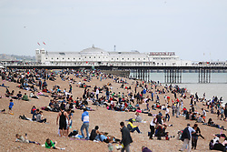 © Licensed to London News Pictures. 25/05/2015. Brighton, UK. Thousands of people take to the beach in Brighton on the May Bank Holiday Monday, today May 25th 2015. Photo credit : Hugo Michiels/LNP