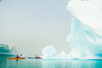 Kayaking through clearing fog and the icebergs on Bear Lake, Kenai Fjords National Park, Alaska