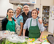 Working seniors in kitchen baby boomer facial expression smiling.