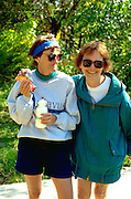Friends age 55 sharing a snack on Great River State Bike trail.   Midway  Wisconsin USA