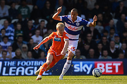 Blackpool's defender Gary MacKenzie and QPR's forward Bobby Zamora  - Photo mandatory by-line: Mitchell Gunn/JMP - Tel: Mobile: 07966 386802 29/03/2014 - SPORT - FOOTBALL - Loftus Road - London - Queens Park Rangers v Blackpool - Championship