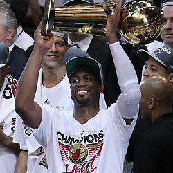 Jun 21, 2012; Miami, FL, USA; Miami Heat shooting guard Dwyane Wade (3) celebrates with the Larry O'Brien championship trophy after winning the 2012 NBA championship at the American Airlines Arena. Miami won 121-106. Mandatory Credit: Derick E. Hingle-US PRESSWIRE