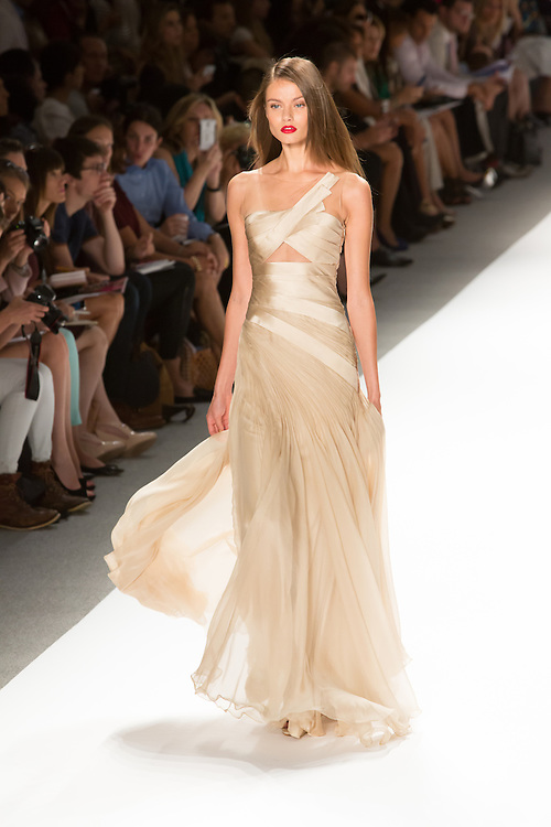 One shoulder pleated gown in cream. By Carlos Miele at the Spring 2013 Mercedes-Benz Fashion Week in New York.