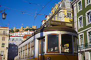 A tipical yellow seen in Figueira Figueira square. On the top of the hill Saint George Castle - Castelo de Sao Jorge can be spoted.