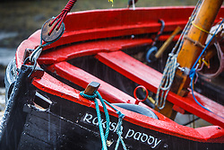Boat (Raking Paddy) in harbor at low tide, Kinvarra, County Galway, Ireland