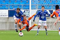 Treningskamp fotball 2014: Molde - Aalesund.  Moldes Daniel Berg Hestad (t.v.) i duell med Fredrik Ulvestad i treningskampen mellom Molde og Aalesund på Aker stadion. Martin Linnes bak til høyre.